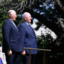 King Harald and Governor-General Peter John Cosgrove listen to the national anthems during the welcoming ceremony in Canberra. Photo: David Gray, Reuters / NTB scanpix