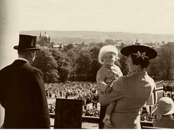 King Harald on the Palace Balcony for the first time - 17 May 1938. Unknown photographer, the Royal Collections