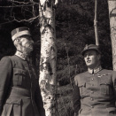 "They keep traveling north. Here: King Haakon and Crown Prince at ""the King's Birch"" outside Molde. The picture was to become an important symbol of Norwegian resistance. Photo: Per Bratland, Nina Bratland's archive."