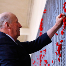 The names of Australia's fallen soldiers are inscribed in bronze in the Roll of Honour. King Harald placed a paper poppy by one of the names today. Photo: David Gray, Reuters / NTB scanpix