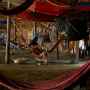 In the circular communal dwelling of the Yanomami, all of the 120 village inhabitants sleep in hammocks under the same roof. (Photo: Rainforest Foundation Norway / ISA Brazil)