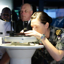 King Harald got to see one of the simulators delivered by Kongsberg Maritime in action. Photo: Lise Åserud, NTB scanpix