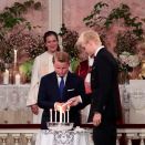 The Princess' brothers, Prince Sverre Magnus and Marius Borg Høiby, light their candles. Photo: Lise Åserud / NTB scanpix  Photo: Lise Åserud / NTB scanpix